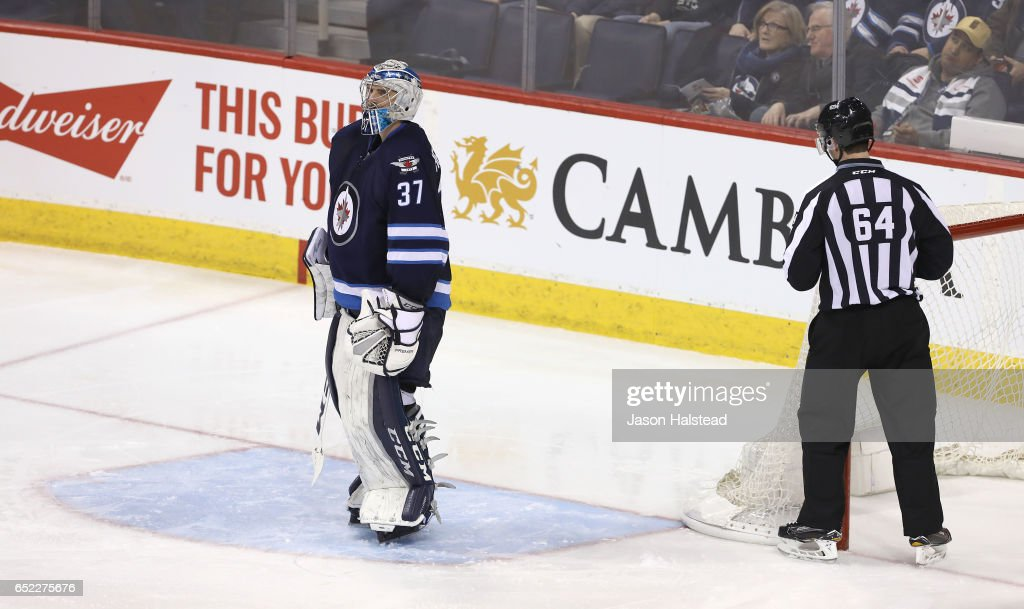 Connor Hellebuyck #37 of the Winnipeg Jets looks up after being scored on by Alex Chiasson #39 of the Calgary Flames during NHL action on March 11, 2017 at the MTS Centre in Winnipeg, Manitoba.