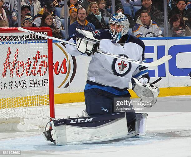 Connor Hellebuyck of the Winnipeg Jets makes a save against the Buffalo Sabres during an NHL game at the KeyBank Center on January 7 2017 in Buffalo...