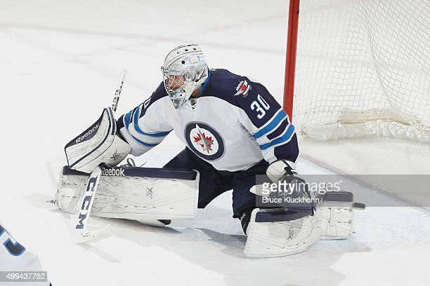 Connor Hellebuyck of the Winnipeg Jets makes a save against the Minnesota Wild during the game on November 27 2015 at the Xcel Energy Center in St...