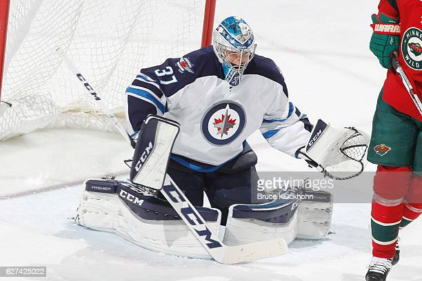 Connor Hellebuyck of the Winnipeg Jets makes a save against the Minnesota Wild during the game on November 23 2016 at the Xcel Energy Center in St...