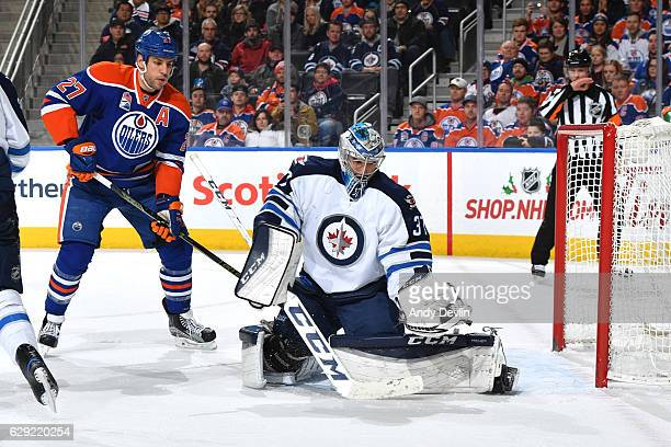 Connor Hellebuyck of the Winnipeg Jets makes a save during the game against the Edmonton Oilers on December 11 2016 at Rogers Place in Edmonton...