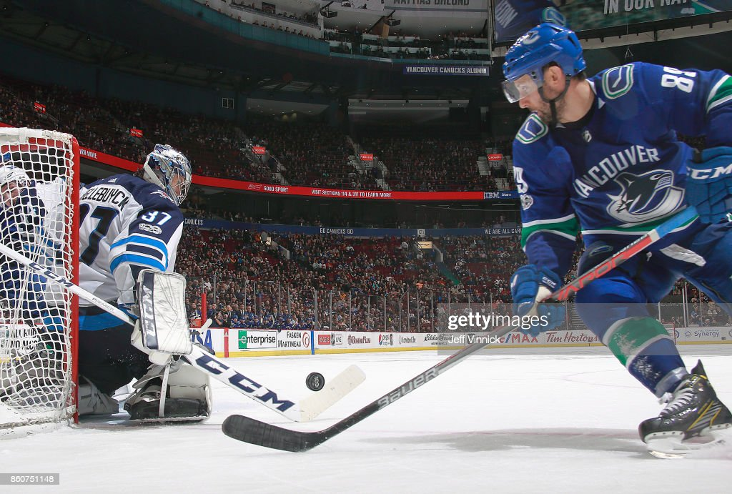 Connor Hellebuyck #37 of the Winnipeg Jets makes a save off the shot of Sam Gagner #89 of the Vancouver Canucks during their NHL game at Rogers Arena October 12, 2017 in Vancouver, British Columbia, Canada. The Winnipeg Jets won 4-2.