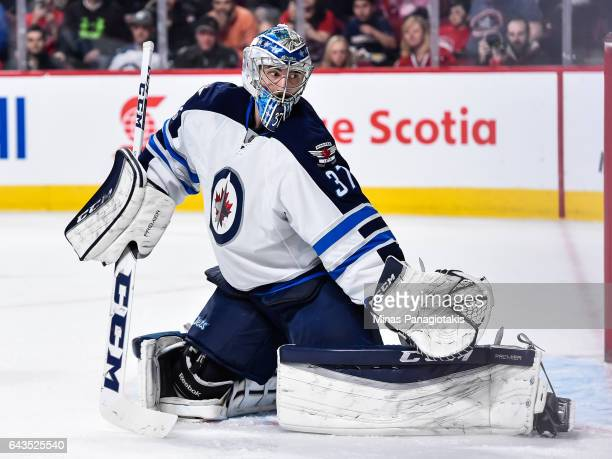 Connor Hellebuyck of the Winnipeg Jets protects his net during the NHL game against the Montreal Canadiens at the Bell Centre on February 18 2017 in...