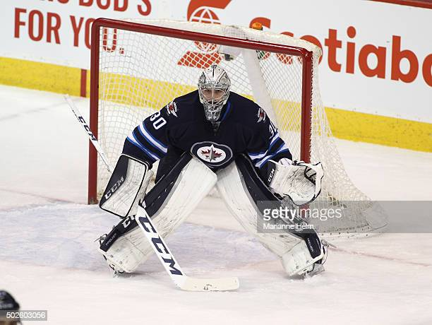 Connor Hellebuyck of the Winnipeg Jets protects the net in first period action in an NHL game against the New York Rangers at the MTS Centre on...
