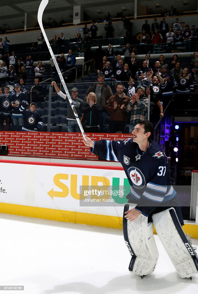 Connor Hellebuyck #37 of the Winnipeg Jets raises his stick to salute the fans after receiving first star honors following a 4-1 victory over the Arizona Coyotes at the Bell MTS Place on November 14, 2017 in Winnipeg, Manitoba, Canada.