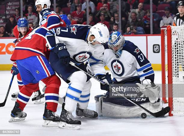 Connor Hellebuyck of the Winnipeg Jets stops a shot by the Montreal Canadiens in the NHL game at the Bell Centre on February 18 2017 in Montreal...