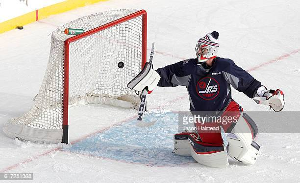 Connor Hellebuyck of the Winnipeg Jets takes part in practice in preparation for the 2016 Tim Hortons NHL Heritage Classic alumni hockey game on...