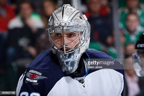 Connor Hellebuyck of the Winnipeg Jets tends goal against the Dallas Stars at the American Airlines Center on January 7 2016 in Dallas Texas