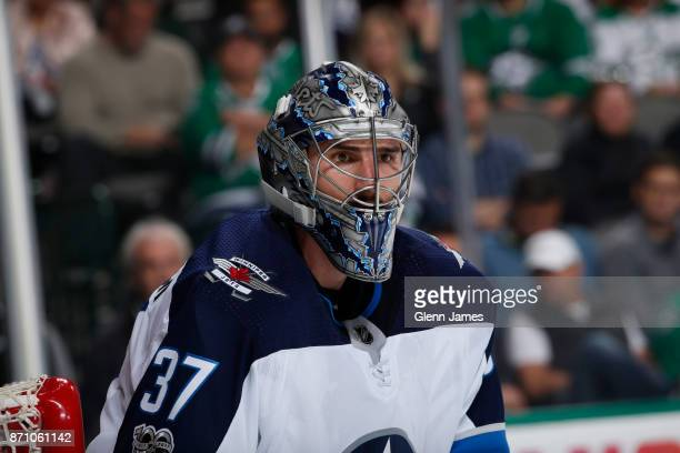 Connor Hellebuyck of the Winnipeg Jets tends goal against the Dallas Stars at the American Airlines Center on November 6 2017 in Dallas Texas