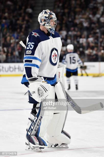 Connor Hellebuyck of the Winnipeg Jets waits for play to resume during the game against the Vegas Golden Knights at TMobile Arena on November 10 2017...