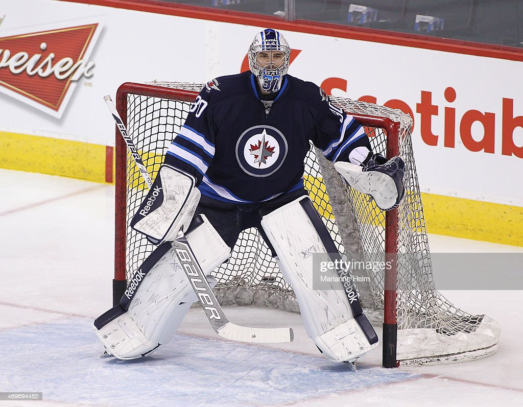 <a gi-track='captionPersonalityLinkClicked' href=/galleries/search?phrase=Connor+Hellebuyck&family=editorial&specificpeople=10551764 ng-click='$event.stopPropagation()'>Connor Hellebuyck</a> #30 of the Winnipeg Jets warms up on the ice prior to an NHL game against the Calgary Flames at the MTS Centre on April 11, 2015 in Winnipeg, Manitoba, Canada.