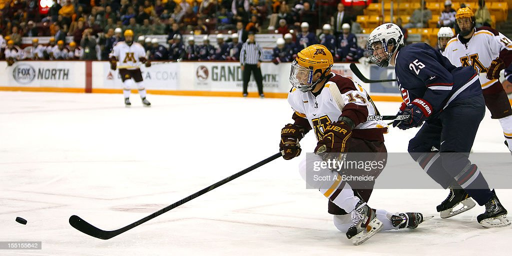 Connor Hurley #25 of United States U-18 takes down Tom Serratore #14 of the University of Minnesota October 26, 2012 at Mariucci Arena in Minneapolis, Minnesota.