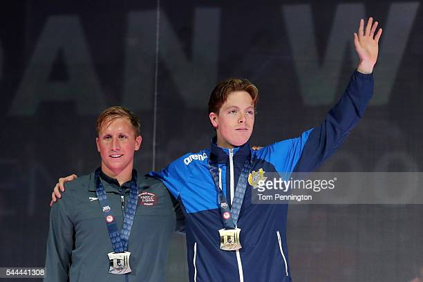 Connor Jaeger and Jordan Wilimovsky of the United States participate in the medal ceremony for the Men's 1500 Meter Freestyle during Day Eight of the...