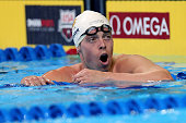 Connor Jaeger of the United States celebrates after finishing first in the final heat for the Men's 1500 Meter Freestyle during Day Eight of the 2016...