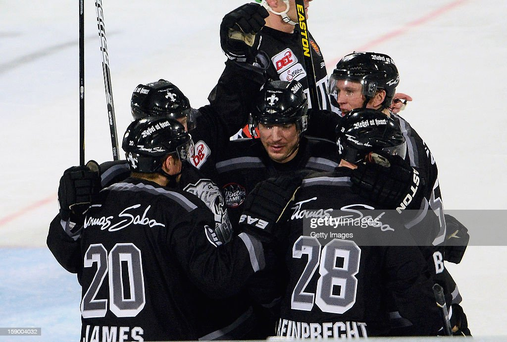 Connor James (L) of Nuremberg celebrates after scoring the opening/first goal with teammates during the DEL Winter Game 2013 at Stadion Nuernberg on January 5, 2013 in Nuremberg, Germany.