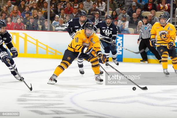 Connor Jones of Quinnipiac looks to pass while playing Yale during the Division I Men's Hockey Championship held at the CONSOL Energy Center in...