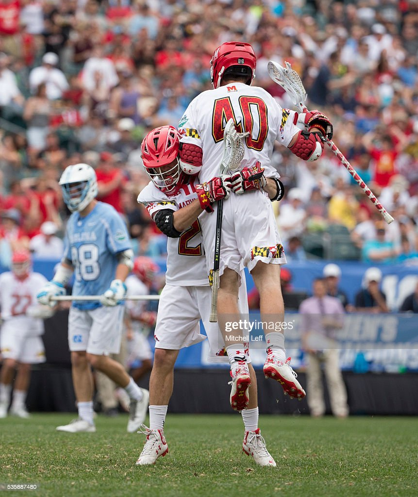 Connor Kelly #40 and Dylan Maltz #25 of the Maryland Terrapins celebrate in front of Kyle Mathie #88 of the North Carolina Tar Heels after a goal in the NCAA Division I Men's Lacrosse Championship at Lincoln Financial Field on May 30, 2016 in Philadelphia, Pennsylvania.