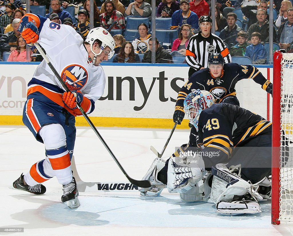 Connor Knapp #49 of the Buffalo Sabres defends the net against John Persson #56 of the New York Islanders at First Niagara Center on April 13, 2014 in Buffalo, New York. New York defeated Buffalo 4-3.