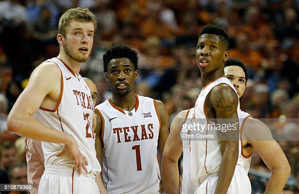 Connor Lammert Isaiah Taylor Kerwin Roach Jr #12 and Javan Felix of the Texas Longhorns stand on the court during the game with the West Virginia...