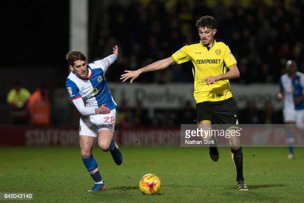 Connor Mahoney of Blackburn Rovers and Tom Flanagan of Burton Albion in action during the Sky Bet Championship match between Burton Albion and...
