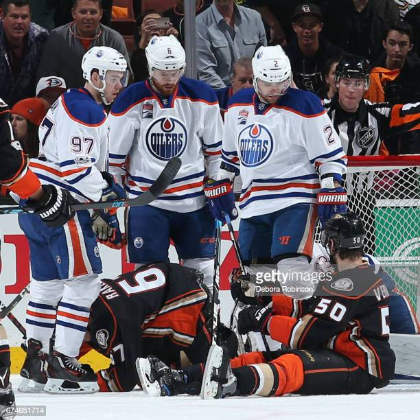 Connor McDavid Adam Larsson and Andrej Sekera of the Edmonton Oilers look down at Rickard Rakell and Antoine Vermette of the Anaheim Ducks in Game...