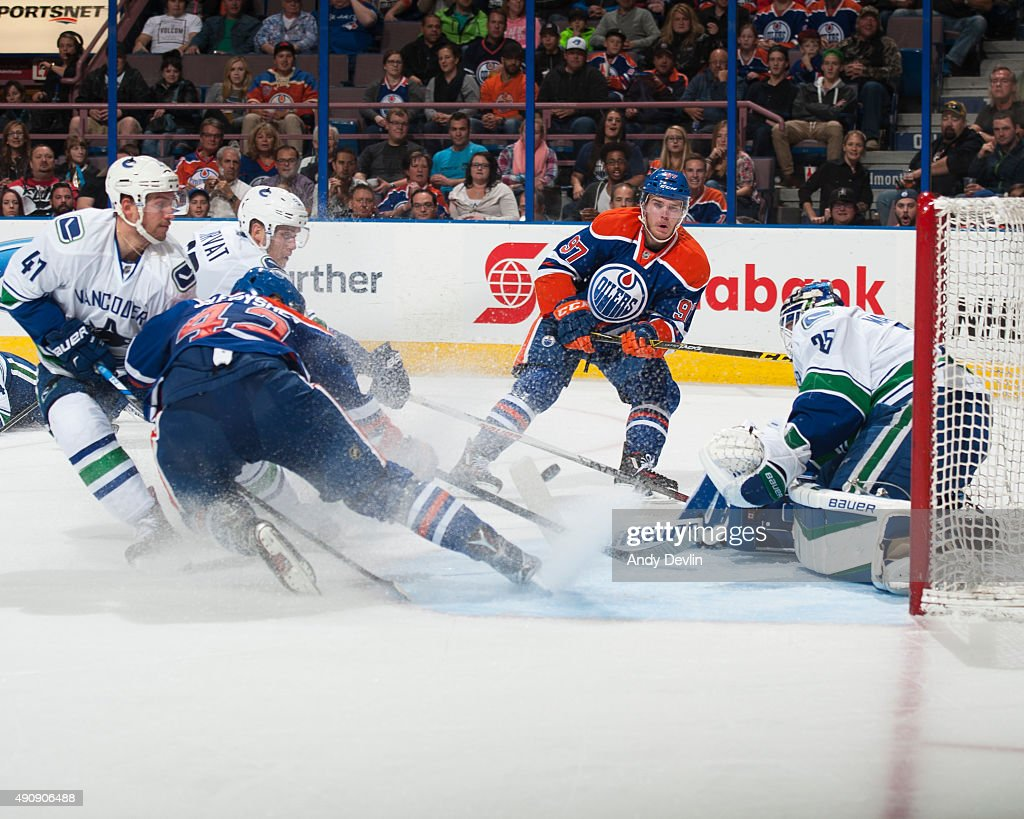 <a gi-track='captionPersonalityLinkClicked' href=/galleries/search?phrase=Connor+McDavid&family=editorial&specificpeople=9756794 ng-click='$event.stopPropagation()'>Connor McDavid</a> #97 and <a gi-track='captionPersonalityLinkClicked' href=/galleries/search?phrase=Anton+Slepyshev&family=editorial&specificpeople=10104519 ng-click='$event.stopPropagation()'>Anton Slepyshev</a> #42 of the Edmonton Oilers send the puck towards the net but are stopped by <a gi-track='captionPersonalityLinkClicked' href=/galleries/search?phrase=Jacob+Markstrom&family=editorial&specificpeople=5370948 ng-click='$event.stopPropagation()'>Jacob Markstrom</a> #25 of the Vancouver Canucks on October 1, 2015 at Rexall Place in Edmonton, Alberta, Canada.