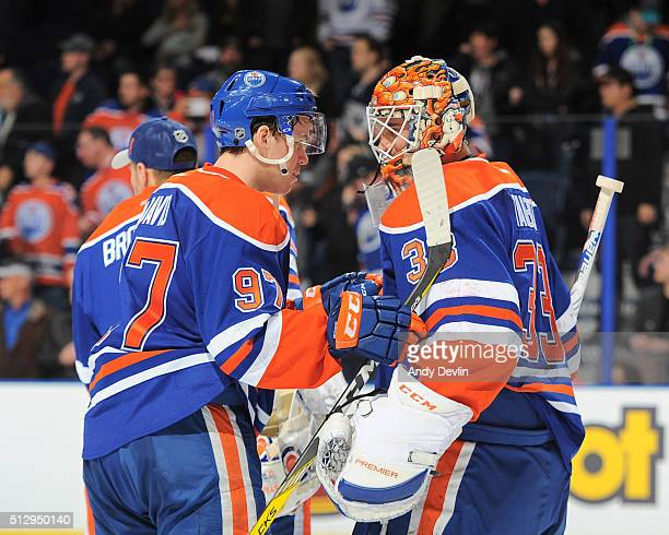 Connor McDavid and Cam Talbot of the Edmonton Oilers celebrate after winning the game against the New York Islanders on February 28 2016 at Rexall...