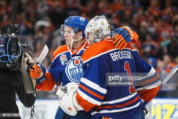 Connor McDavid and goalie Laurent Brossoit of the Edmonton Oilers celebrate their victory against the Vancouver Canucks on April 9 2017 at Rogers...