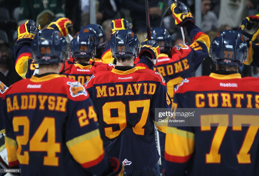 Connor McDavid #97 and his Erie Otters teammates skate off the ice after playing against the London Knights during an OHL game at the Budweiser Gardens on October 25, 2013 in London, Ontario, Canada. The Otters defeated the Knights 5-1.
