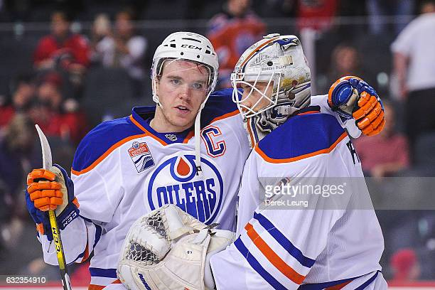 Connor McDavid and Laurent Brossoit of the Edmonton Oilers celebrate after defeating the Calgary Flames during an NHL game at Scotiabank Saddledome...