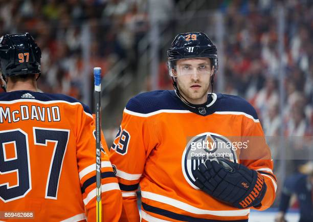 Connor McDavid and Leon Draisaitl of the Edmonton Oilers during a break in play against the Calgary Flames at Rogers Place on October 4 2017 in...
