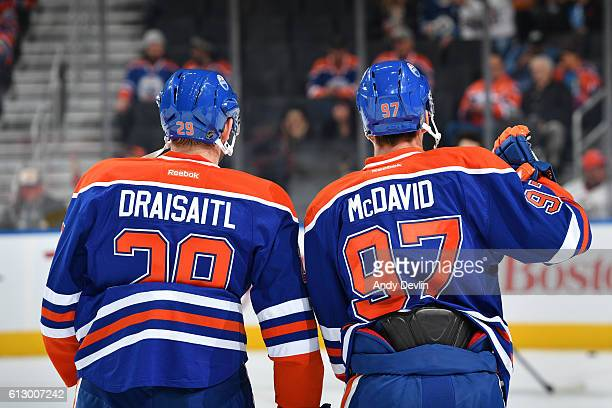 Connor McDavid and Leon Draisaitl of the Edmonton Oilers warm up prior to a preseason game against the Winnipeg Jets on October 6 2016 at Rogers...
