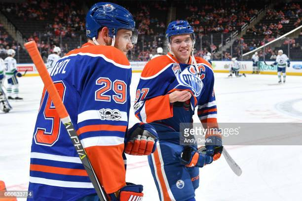 Connor McDavid and Leon Draisaitl of the Edmonton Oilers warm up prior to the game against the Vancouver Canucks on April 9 2017 at Rogers Place in...