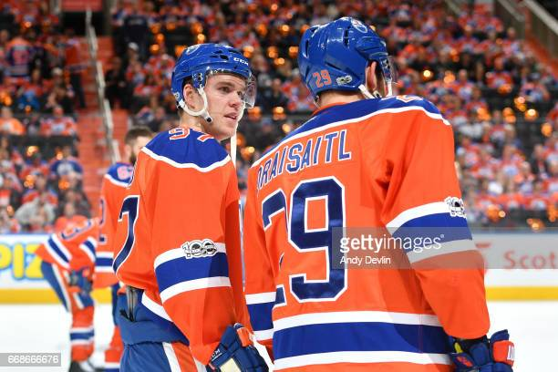 Connor McDavid and Leon Draisaitl of the Edmonton Oilers warm up prior to Game Two of the Western Conference First Round during the 2017 NHL Stanley...