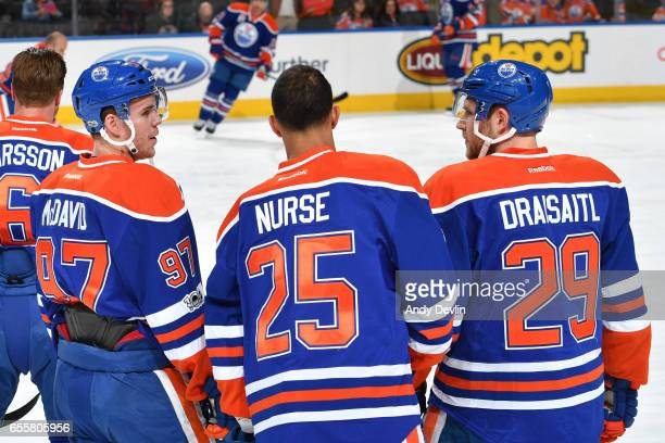 Connor McDavid Darnell Nurse and Leon Draisaitl of the Edmonton Oilers discuss the play prior to the game against the Los Angeles Kings on March 20...