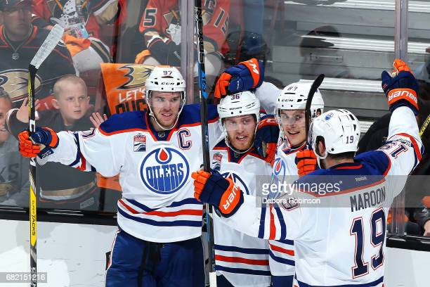 Connor McDavid Drake Caggiula Matthew Benning and Patrick Maroon of the Edmonton Oilers celebrate a goal against the Anaheim Ducks in Game Five of...