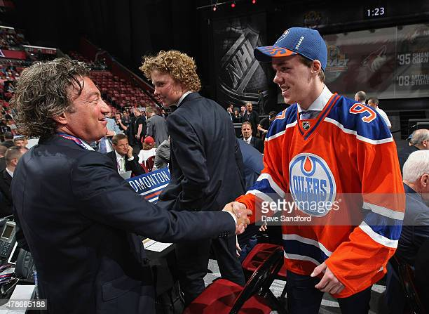 Connor McDavid greets owner Daryl Katz after being selected first overall by the Edmonton Oilers during Round One of the 2015 NHL Draft at BBT Center...