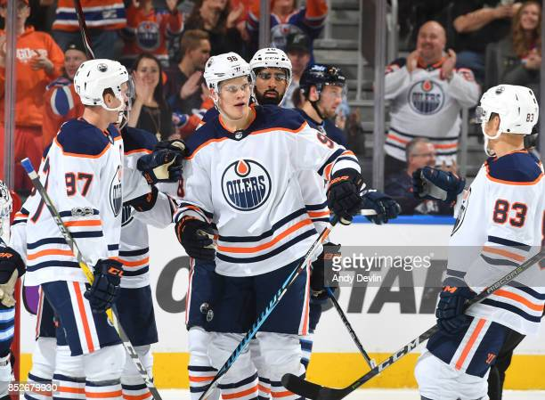 Connor McDavid Jesse Puljujarvi Jujhar Khaira and Matthew Benning of the Edmonton Oilers celebrate after a goal during the preseason game against the...