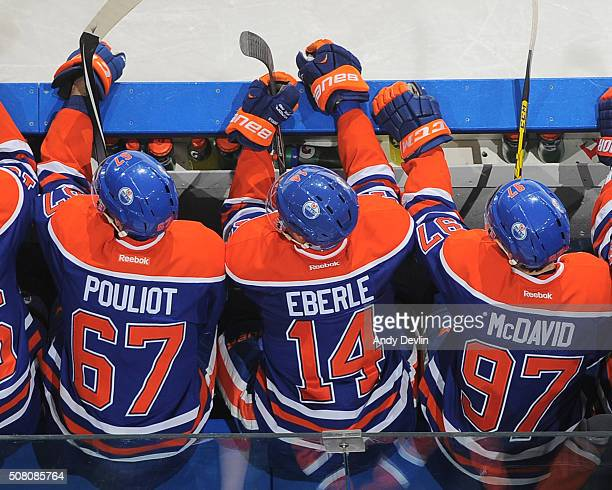 Connor McDavid Jordan Eberle and Benoit Pouliot of the Edmonton Oilers watch play from the bench during a game against the Columbus Blue Jackets on...
