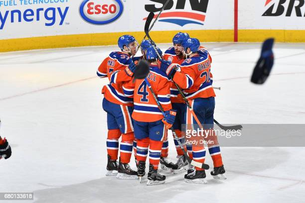Connor McDavid Kris Russell Milan Lucic and Leon Draisaitl of the Edmonton Oilers celebrate after a goal in Game Six of the Western Conference Second...