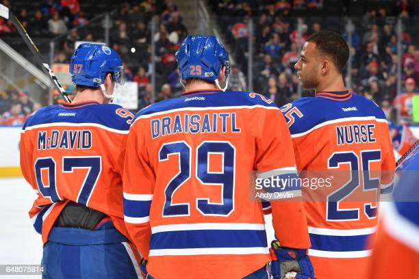Connor McDavid Leon Draisaitl and Darnell Nurse of the Edmonton Oilers warm up prior to the game against the Detroit Red Wings on March 4 2017 at...