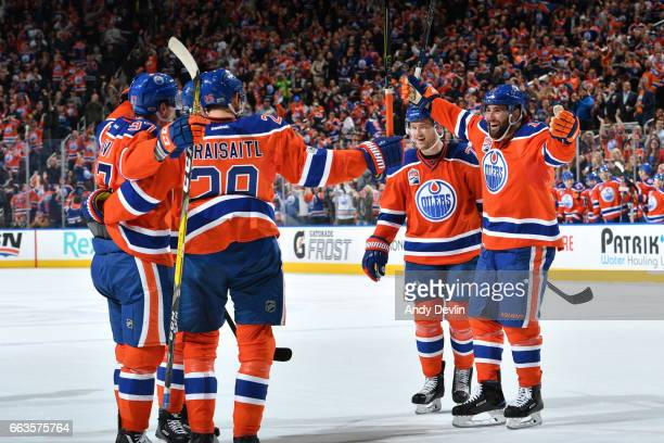 Connor McDavid Leon Draisaitl Oscar Klefbom and Patrick Maroon of the Edmonton Oilers celebrate after a goal during the game against the Anaheim...