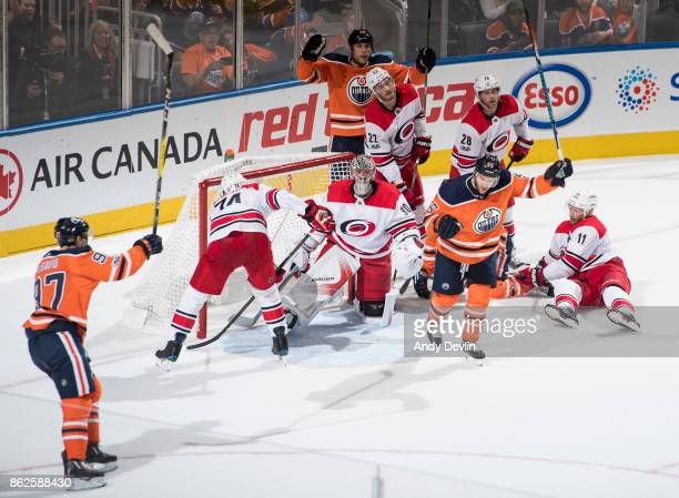 Connor McDavid Milan Lucic and Mark Letestu of the Edmonton Oilers celebrate Letestu's goal on goaltender Cam Ward of the Carolina Hurricanes as...