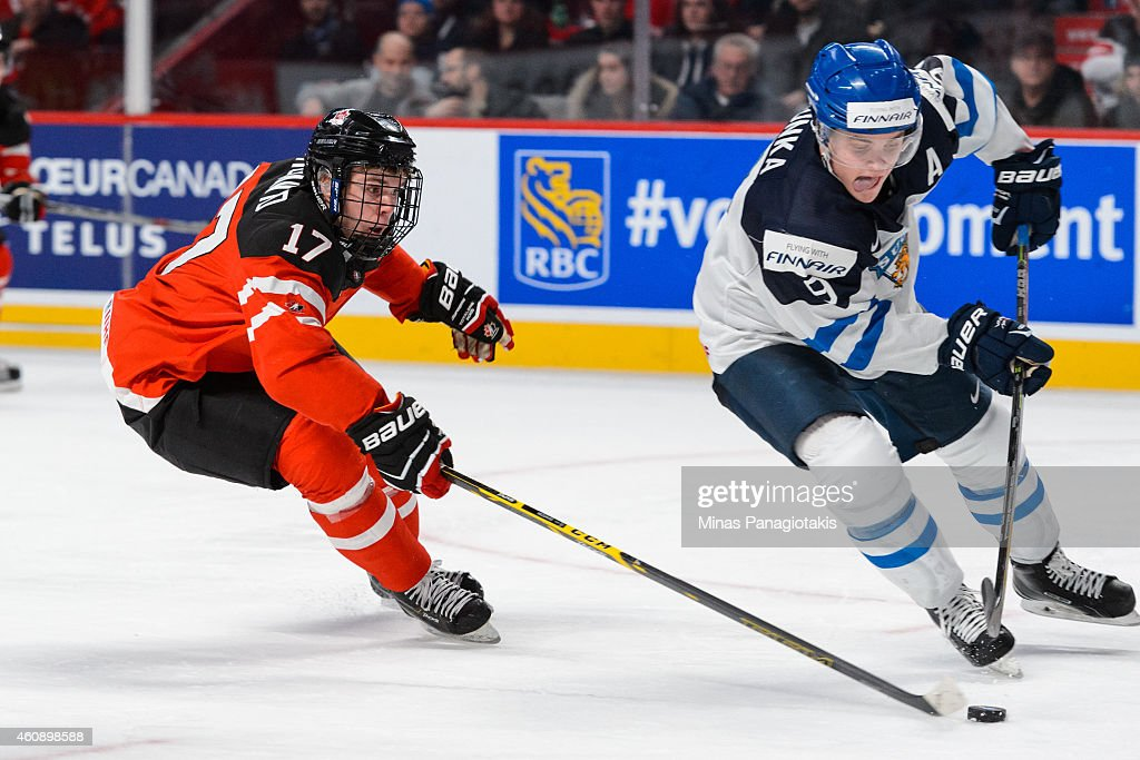 <a gi-track='captionPersonalityLinkClicked' href=/galleries/search?phrase=Connor+McDavid&family=editorial&specificpeople=9756794 ng-click='$event.stopPropagation()'>Connor McDavid</a> #17 of Team Canada follows <a gi-track='captionPersonalityLinkClicked' href=/galleries/search?phrase=Julius+Honka&family=editorial&specificpeople=9966154 ng-click='$event.stopPropagation()'>Julius Honka</a> #9 of Team Finland during the 2015 IIHF World Junior Hockey Championship game at the Bell Centre on December 29, 2014 in Montreal, Quebec, Canada. Team Canada defeated Team Finland 4-1.