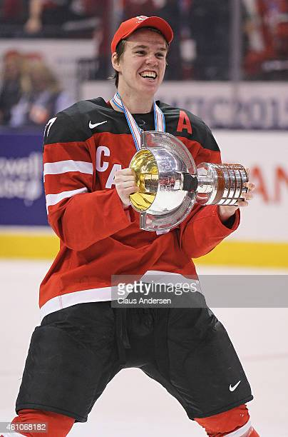 Connor McDavid of Team Canada skates with the winning trophy after defeating Team Russia in the Gold medal game in the 2015 IIHF World Junior Hockey...