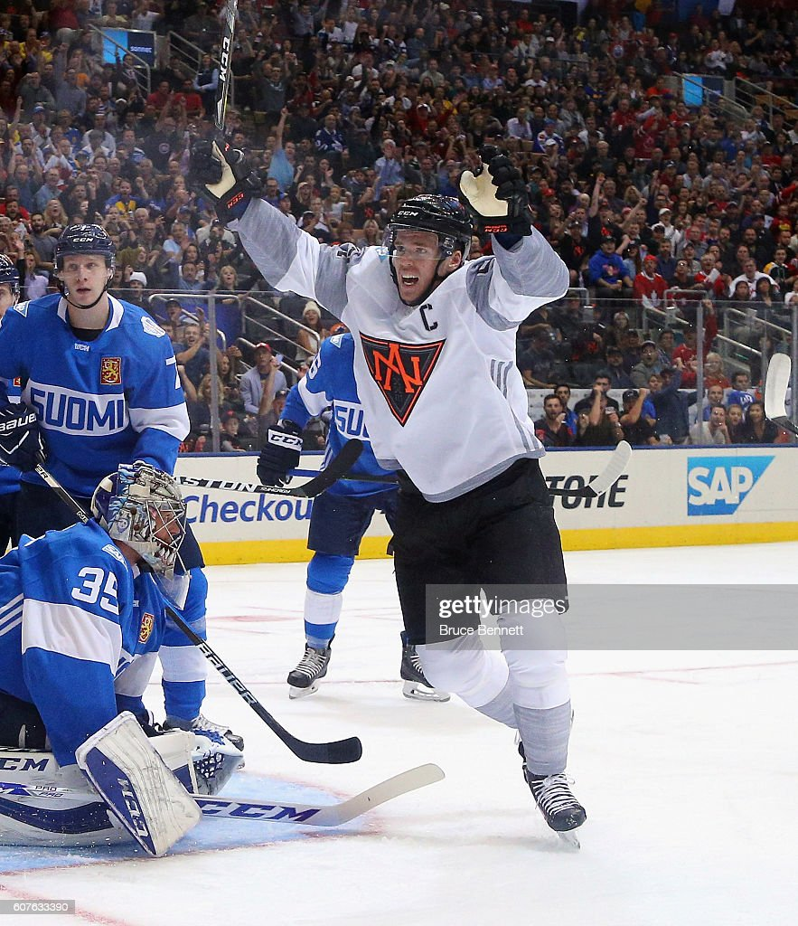 Connor McDavid #97 of Team North America celebrates a first period goal by Jack Eichel #15 against Team Finland during the World Cup of Hockey tournament at the Air Canada Centre on September 18, 2016 in Toronto, Canada.