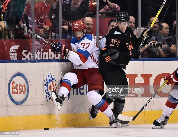 Connor McDavid of Team North America collides with Ivan Telegin of Team Russia along the boards during the World Cup of Hockey 2016 at Air Canada...
