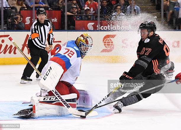 Connor McDavid of Team North America tries to get the puck past Sergei Bobrovsky of Team Russia during the World Cup of Hockey 2016 at Air Canada...