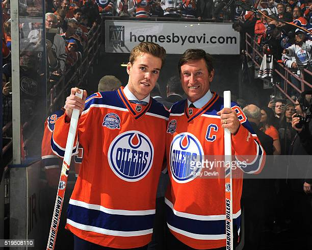 Connor McDavid of the Edmonton Oilers and Wayne Gretzky of the Edmonton Oilers Alumni pose for a photo following the Farewell To Rexall Place...