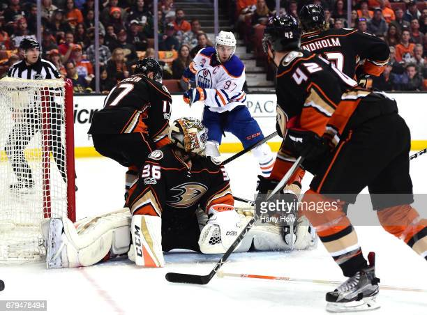 Connor McDavid of the Edmonton Oilers bats the puck out of the air to score a power play goal past John Gibson and Ryan Kesler of the Anaheim Ducks...